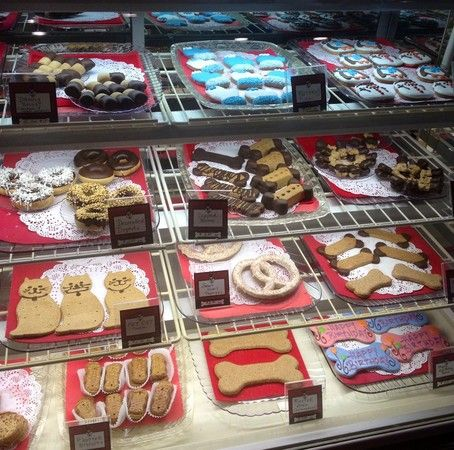 Unique Dog Bakery Opens in -Corona del Mar. Top Dog Barkery features a bakery case filled with fresh-baked dog treats and shelves stacked with gifts for dog lovers.