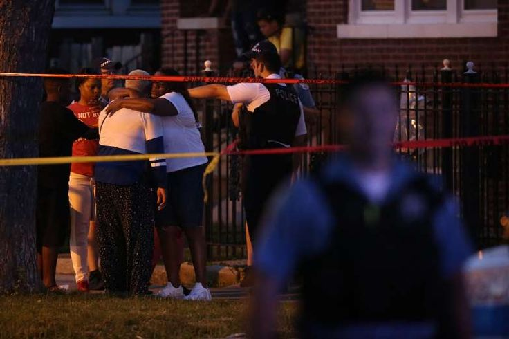 Chicago police express frustration after more than 100 shot in violent Fourth of July weekend  -  July 6, 2017:     People gather at the scene where two were shot on the block of 1600 N Major in the North Austin neighborhood, Tuesday, July 4, 2017 in Chicago. (E. Jason Wambsgans/Chicago Tribune/TNS)