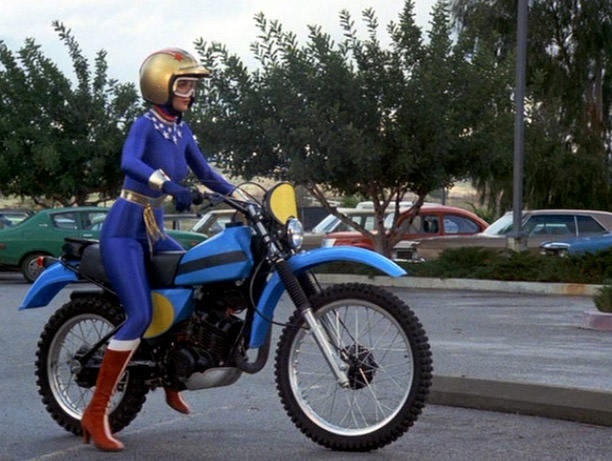 Wonder Woman on motorcycle.    I like that she's wearing a motorcycle helmet.  She's setting a good example.