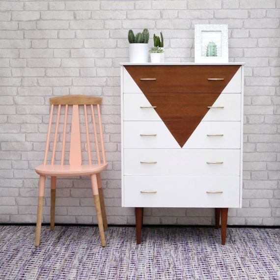 A genuine mid century chest of drawers, carefully restored in white with triangle design. A truly unique piece that will create a focal point in your…