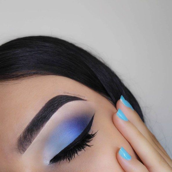 @thecutestberry is a babe in blue!  She is wearing our Mega Liner Liquid Eyeliner in Black and Color Icon Glitter Single in Spiked on the inner corner of her eye! #wetnwildbeauty #crueltyfree #eotd