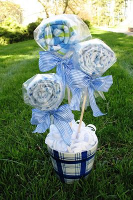 Adorable baby shower centerpiece that doubles as a gift... those are burp cloths! With tutorial.