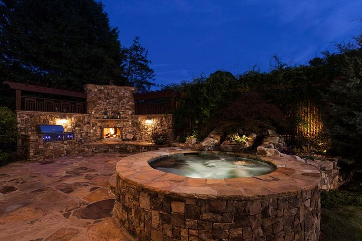 Mediterranean Hot Tub with outdoor pizza oven, Outdoor kitchen, Fence, exterior stone floors, Trellis