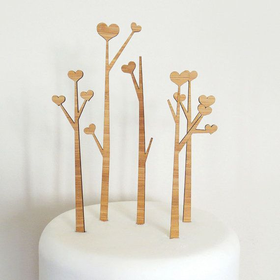 I love this with the idea of stringing tiny bunting from tree to tree.  Heart Trees Cake Topper Set  Bamboo  Wedding Cake Topper  by Cabin, $40.00