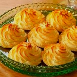 Duchess Potatoes look so elegant and yet they're easy to make. Season your favorite mash potatoes to taste and then pipe into rosette shapes. Brown under the broiler until golden. A perfect roast accent.