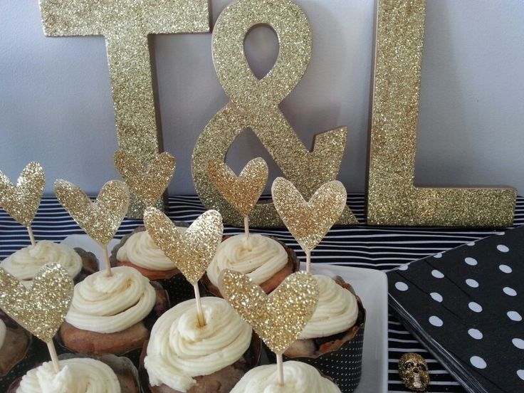 Gold sparkley heart cake toppers for a black and gold engagement party