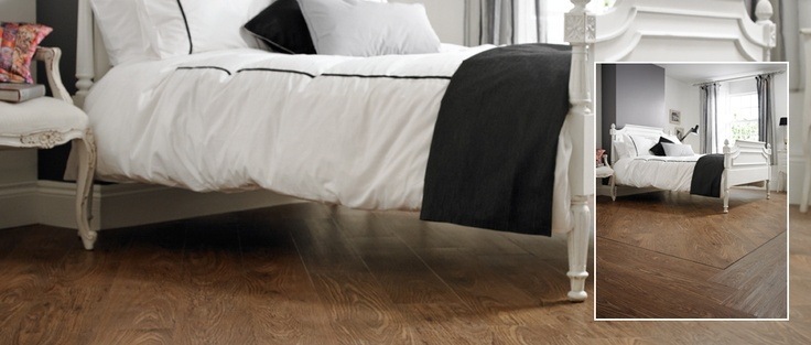 INNOVA - Dark Oak - A truly stunning wood, laid on the angle with a single Black Design Strip border to add definition to this large bedroom. Available from Rodgers of York #Interiors #Flooring
