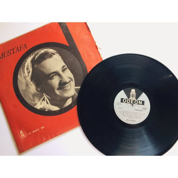▴△▴Vintage Turkish Music Vinyl Record, Mustafa Sağyaşar, 1950s 1960s • Odeon, 33RPM, Red, Cigarette Mustache, Leyla, Extremely Rare, Love Songs, Mod Retro, Ethnomusicology▴△▴  Mustafa Sağyaşar is a classic Turkish music singer, eastern-influenced with Ottoman history soaked in every rhythm, and conductor. Great idea for Turkophiles, ethnomusicologists and music lovers! Ready-to-frame for any office, dorm, room, work area, creative space, music store, etc!  facebook.com/museum83