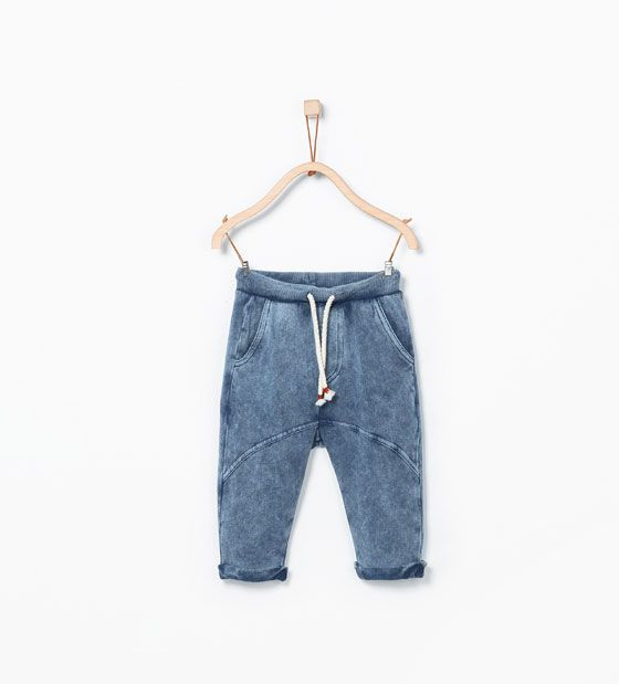 Image 1 of Seamed faded trousers. from Zara
