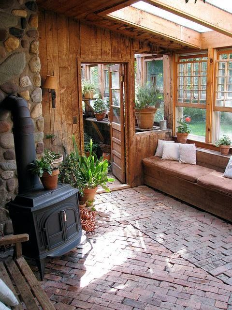 Sun room inspiration with woodstove and attached laundry room