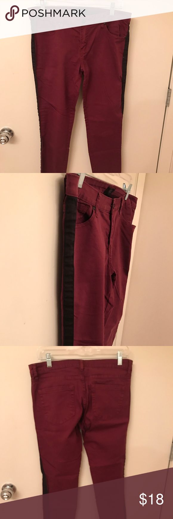 Maroon skinny jeans with black side stripe Maroon skinny jeans with black side stripe. Very flattering on! Forever 21 Jeans Skinny