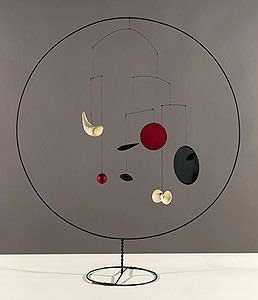 "Alexander Calder  The Circle, 1934  Wire, sheet metal, wood, ceramic, string,   and paint  35 7/8"" x 31 3/8"" x 13"""