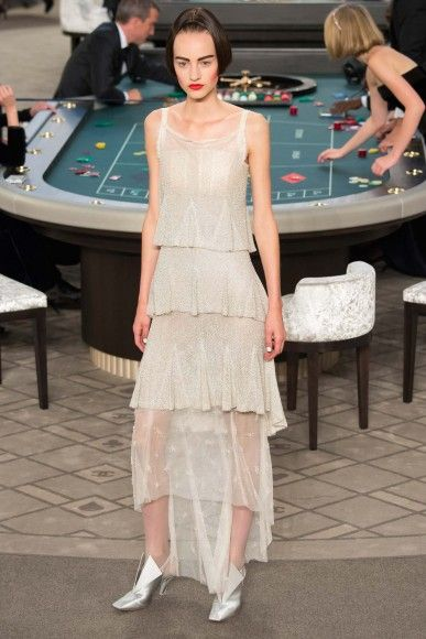 From classic suits to glitzy dresses, Chanel's Casino Royale runway show dazzled the crowd. See the looks that stole the show.