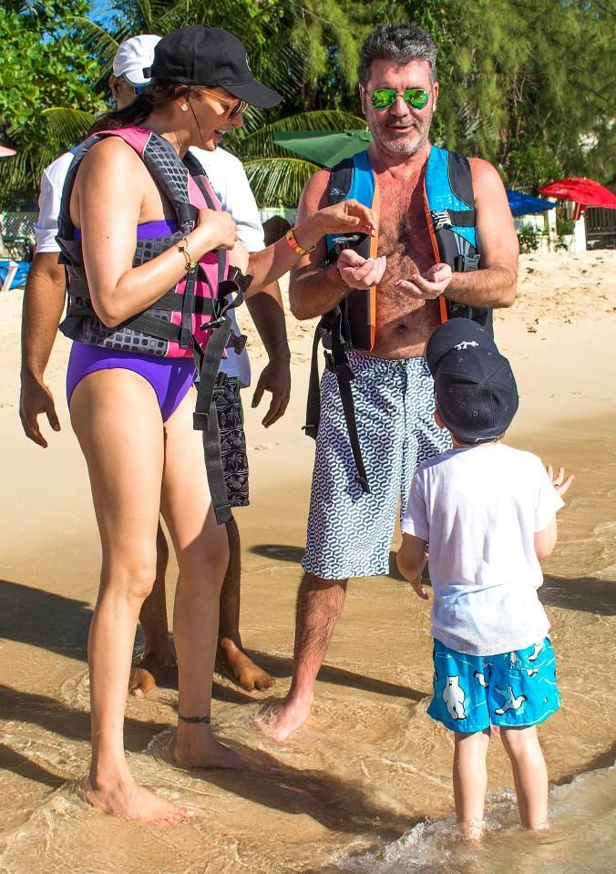 Simon Cowell and Lauren Silverman with son Eric on the beach in Barbados