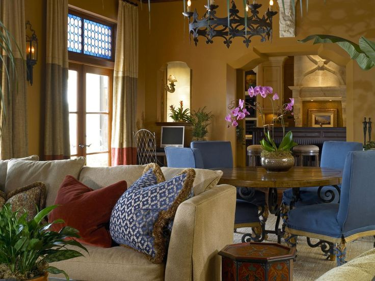 A wrought iron chandelier terra cotta colored walls and for Old fashioned living room designs