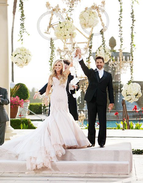 The altar was decorated with gold chandeliers, hanging white flowers and an upside down bicycle. | Tamra Barney wed Eddie Judge on Saturday, June 15.