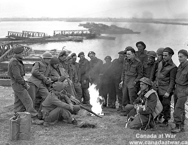 Canadians in Germany - Sapper of the 29th, 30th and 31st Field Companies, Royal Canadian Engineers (R.C.E.), on the bank of the Rhine River, Rees, Germany, 30 March 1945.Lieut. Barney J. Gloster / Canada. Dept. of National Defence / Library and Archives Canada / PA-179789