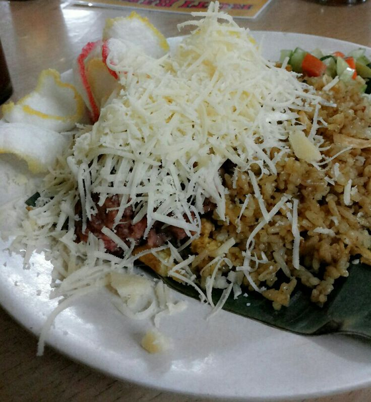 Indonesian fried rice with corned beef, cheese and crackers.. delicious. .