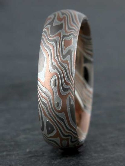 Mokume Gane of a mixture of 3 metals by James Binnion. Your ring is custom made to order with your choice of metals, profile of the ring, and much more.