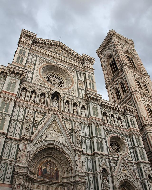 """Cattedrale di Santa Maria del Fiore (Florence Cathedral) with Cloudy Weather - - - The Cattedrale di Santa Maria del Fiore (in English """"Cathedral of Saint Mary of the Flowers"""") is the main church of Florence, Italy. . Il Duomo di Firenze, as it is ordinarily called, was begun in 1296 in the Gothic style with the design of Arnolfo di Cambio and completed structurally in 1436 with the dome engineered by Filippo Brunelleschi. . The exterior of the basilica is faced with polychrome marble panels…"""