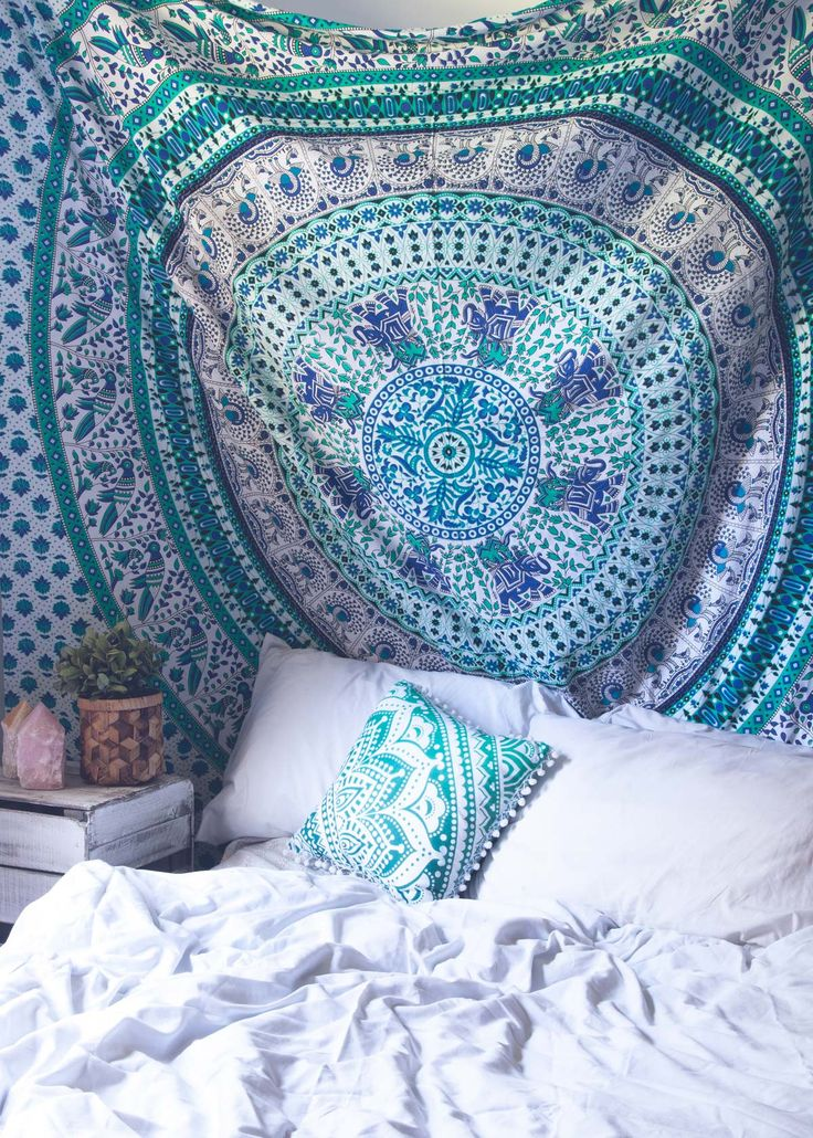 Top off your bed or accent a wall with this unique boho tapestry, featuring a beautiful turquoise and green mandala pattern on soft white fabric. This tapestry also doubles as a picnic blanket, perfec