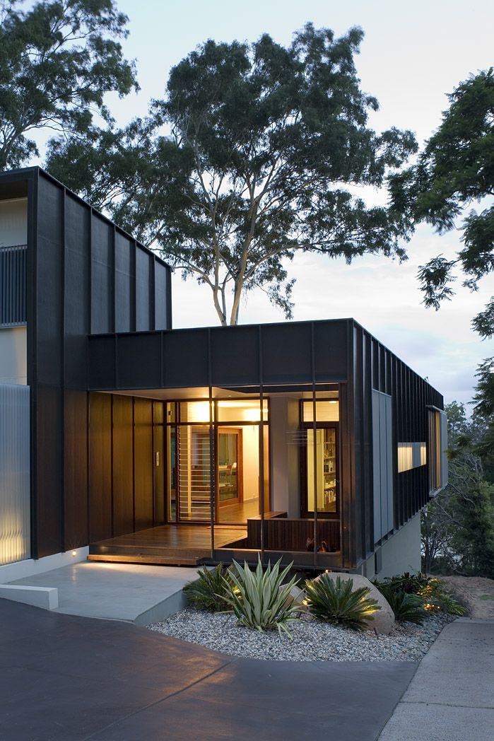 Fig Tree Pocket House 2: Entry emits warm glow at dusk. See more at http://blighgraham.com.au/projects/fig-tree-pocket-house-2