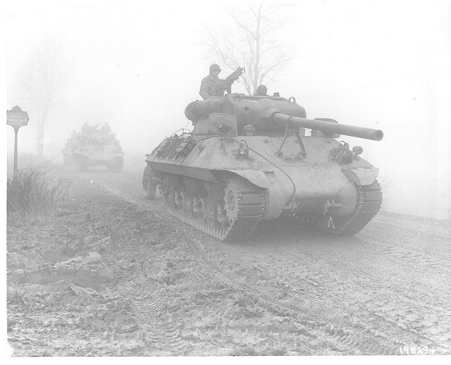 Tank destroyers attached to the 82nd Airborne Division move up in the fog toward Chenaux, December 20, 1944., Belgium.