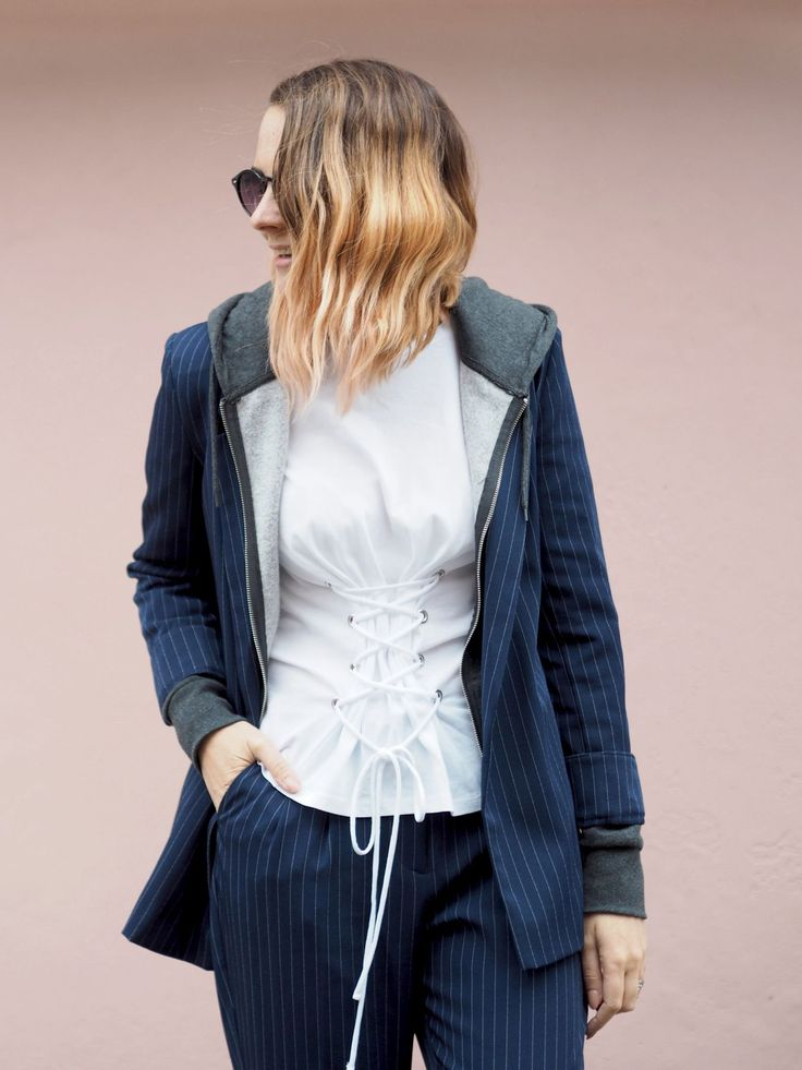 Pinstripe primark suit with hoody underneath and lace up corset tshirt, white trainers. Rose gold hair