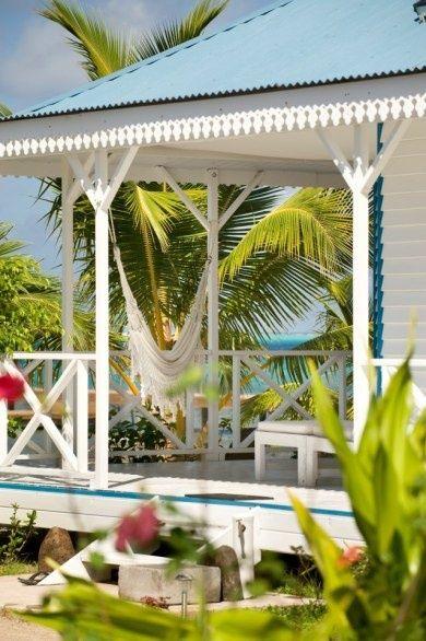 Tropical Aqua + Beach Cottage + Porch + Ocean front + Palms