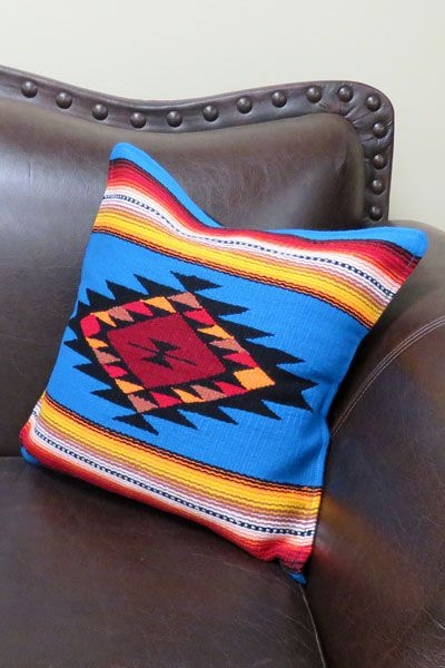 "Intricate woven in classic saltillo serape designs, the ultra soft acrylic material allows for vibrant colors. Imported.   Measures 18"" x 18"". Solid canvas back with velcro close.  Pillow insert included."