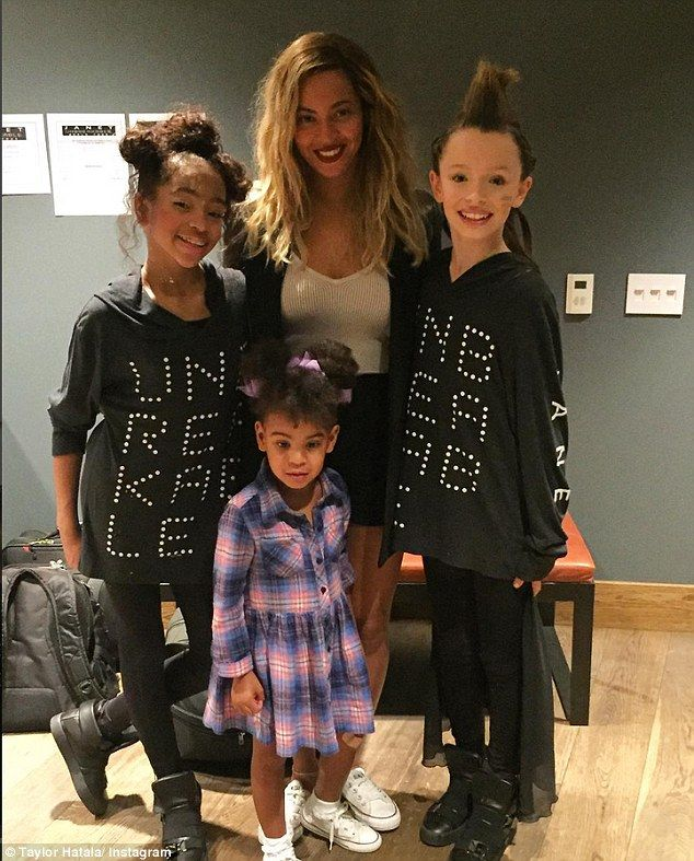 Fun Friday! Beyonce Knowles, top middle, took her daughter Blue Ivy, bottom middle, to the Janet Jackson concert at the Forum in Inglewood, California on Friday