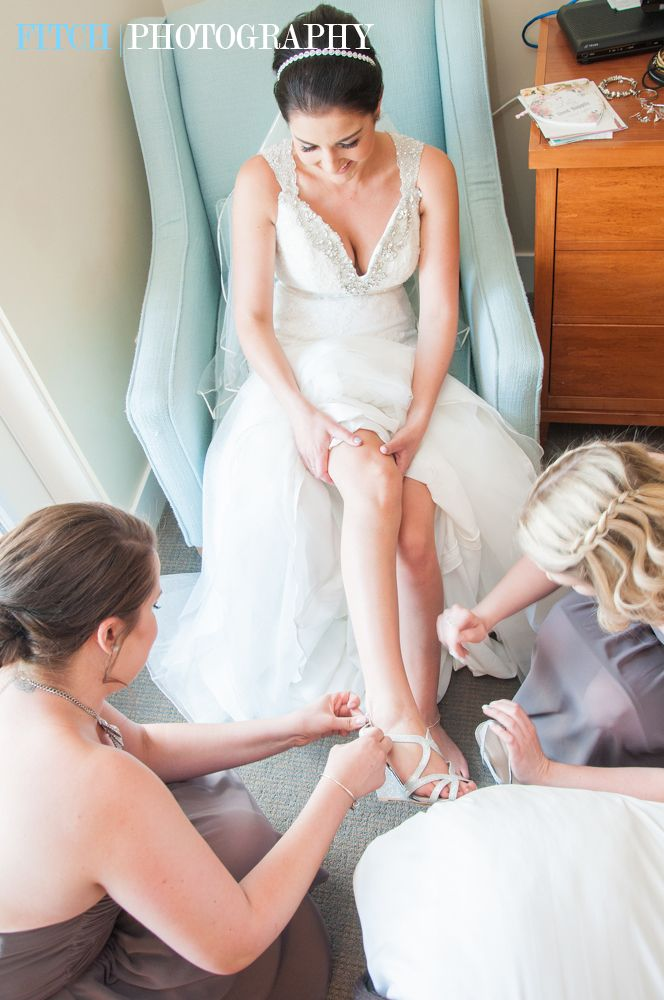 Bride getting ready!  Beautiful bridesmaids are there to help with all the final details! #gettingready #weddingphotography #bride #bridesmaids
