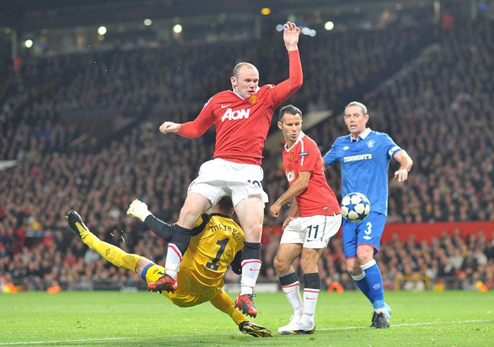 Man Utd 0 Rangers 0 in Sept 2010 at Old Trafford. Allan McGregor tips the ball away from Wayne Rooney in the Champions League, group stage.
