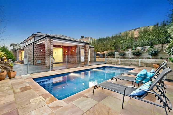 Sparkling pool with sandstone surrounds