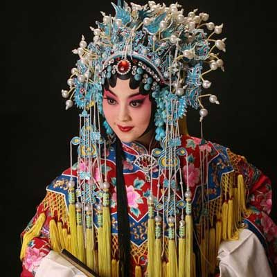 This is a traditional Chinese  actress. They are big on wearing bright colors , big headpieces and jewelry.