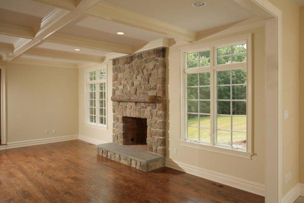 Stone fireplace - just imagine the ceiling vaulting up towards the left... but windows, floors, fireplace.. perfect for stan and mary!!!!