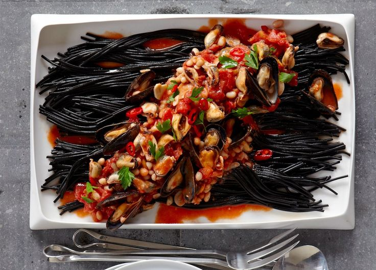 Squid ink pasta with mussels and bean and tomato sauce