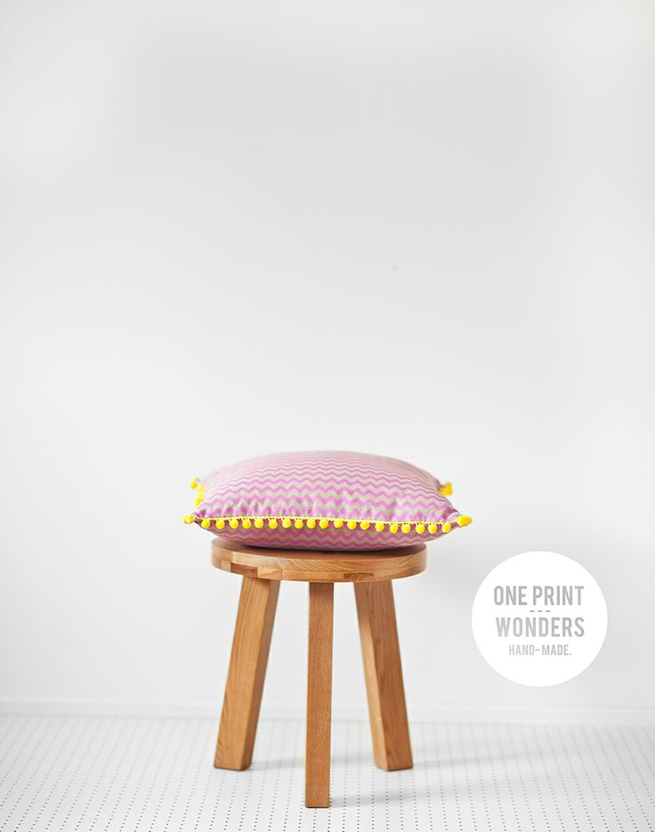Lil Chevs in fuchsia with yellow pom-pom trim. © One Print Wonders