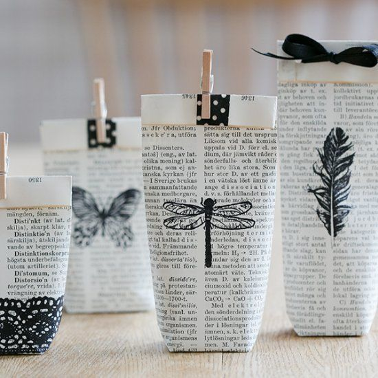 Use pages from an old book, stamp and fold them into small gift bags. Tutorial in English and Swedish. Cool, thanks so xox