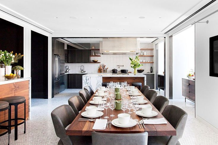 A custom-made walnut dining table and Minotti chairs are the center of attention in the sunny BA Kitchen; the shimmering mosaic floor is by Marazzi Tile.