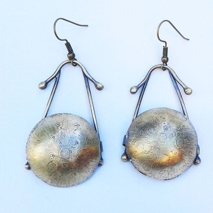 Etched, domed and oxidized brass earrings.