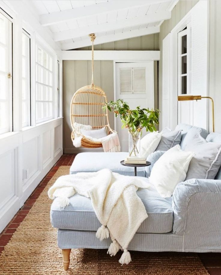Bright sun room with cozy furniture