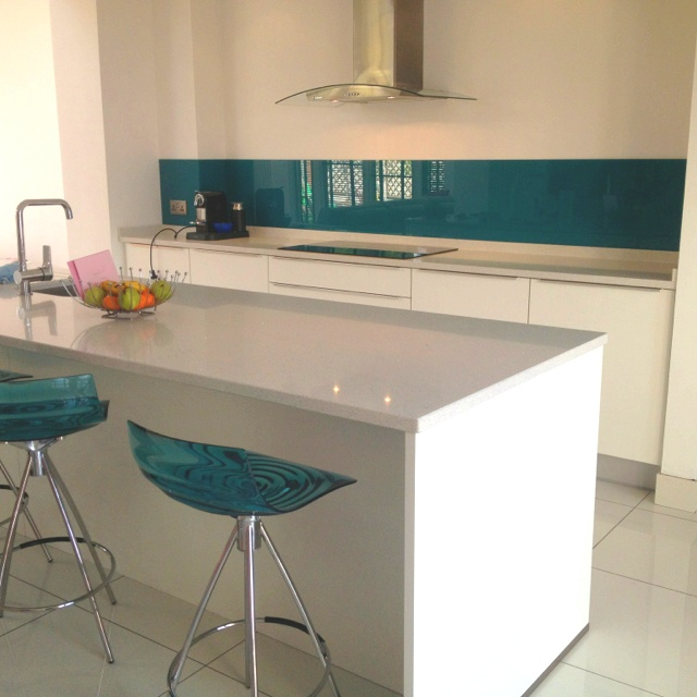Matching glass Splashback and coloured stools