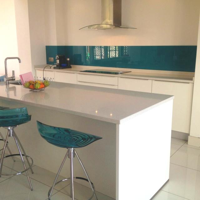 Matching glass Splashback and coloured stools