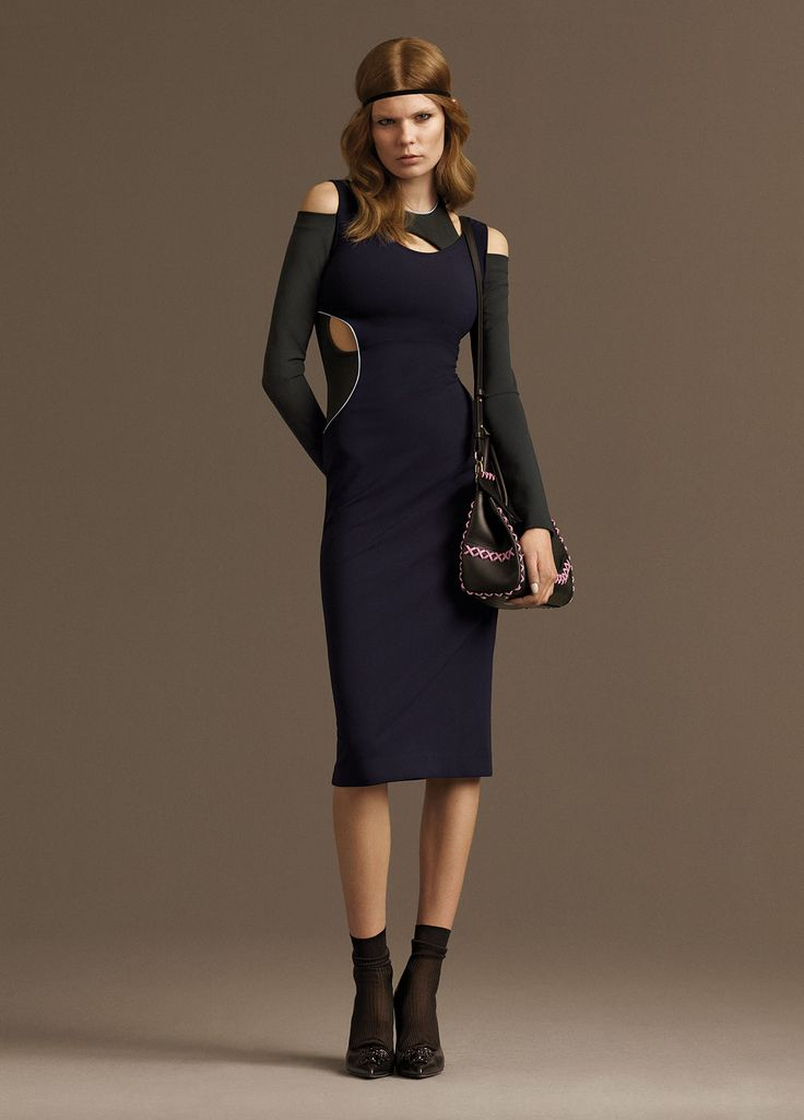 This fitted #Versace dress is smart for a luncheon and sensual for an evening out. Find the best dress for every occasion here: http://goo.gl/oIZCFL #7D7D