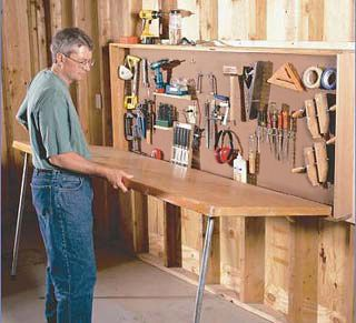wall mounted workbench made from prehung door, could try something similar with the door I already have