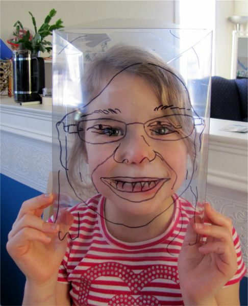 Get the kids to draw their face with a transparency and a mirror.