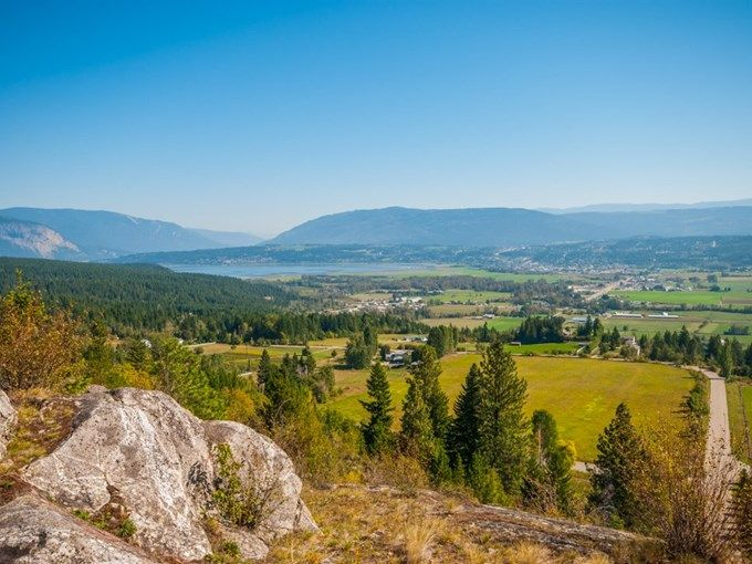 Home for Sale - 6701 SW 15 AVE 4, Salmon Arm, BC V1E 1R5 - MLS® ID 10090225. 11.29 acre lot with deep drilled well and private bridge. Perfect site to build the highest house on the hill, with easy access to the sledding and dirt bike trails of the beautiful Fly Hills.