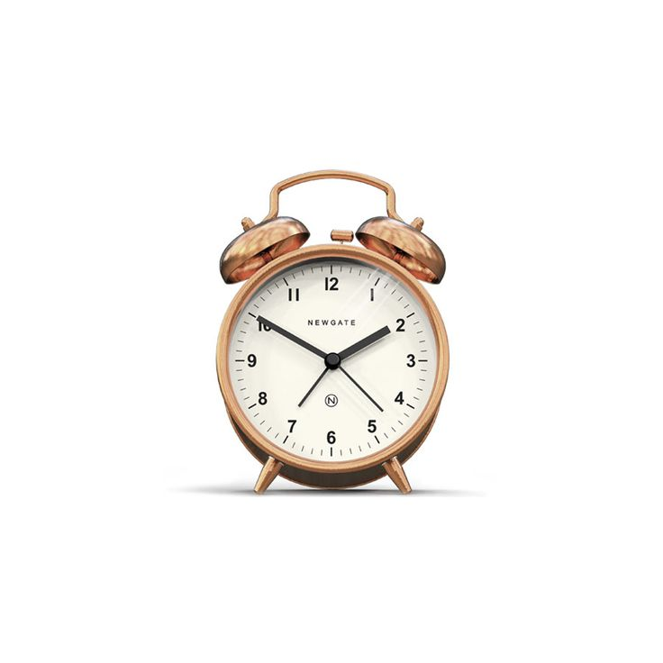 A contemporary copper alarm clock with a modern graphic dial.