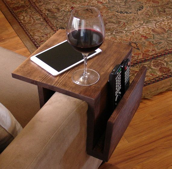 Handmade arm rest tray table with slight overhang and side storage slot. The perfect addition to a sofa in any home, apartment, condo, or man cave.  It
